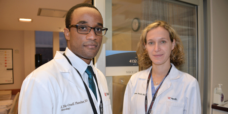 Joao Mc-O'Neil Plancher, MD, and Simona Ferioli, MD, in the neuroscience intensive care unit, where a heroin victim was treated. Photo by Mary Kemper.