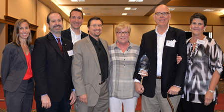 From left, at the 2015 Sunflower Symposium: Cara Jacob, MD, Kim Seroogy, PhD, Andrew Duker, MD, George Mandybur, MD, Linda Mueller, Victory Award winner Tom Mueller, and Maureen Gartner, NP-C.