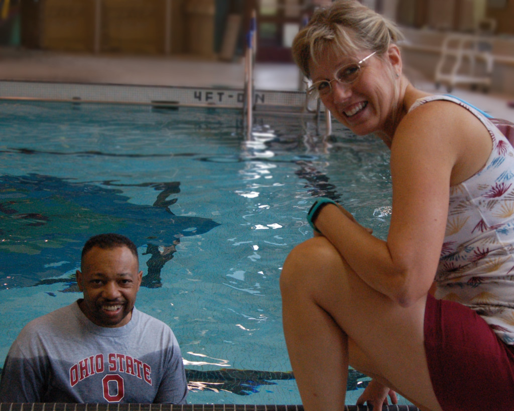 Eric Smith in the pool with aquatic specialist Lisa Newport