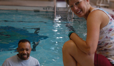 Eric Smith in the Daniel Drake Center pool with aquatic specialist Lisa Newport