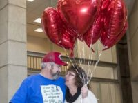 Heart Transplant patient and wife hold balloons