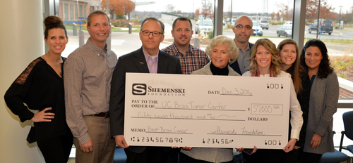 Group of people awarded large check