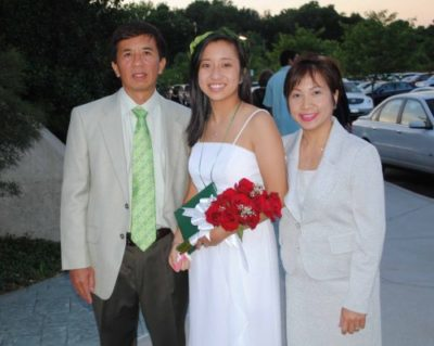 Young woman with her parents at graduation